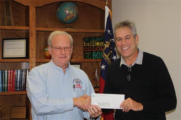 Jefferson Energy Cooperative Presents Check to the Jefferson County School System